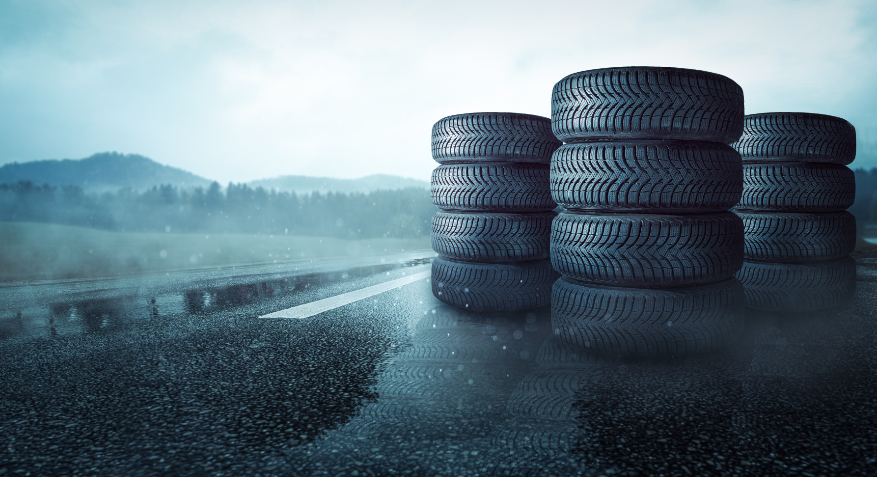 Stack of tyres on a rain covered motorway.