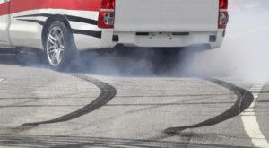 Emergency braking wheel with smoke on the highway and skidding.