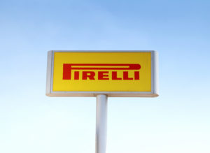 Large Pirelli sign on a stand, close-up.